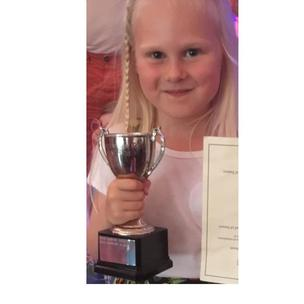 Faye Basham age 5 (Haverhill, Suffolk) started musical theatre class 18 months ago. Was very shy and now this July she has won the cup for musical theatre. She is now full of confidence and inspires and gives confidence to the younger children in her local dance/musical theatre class. A true inspiration to those around her.