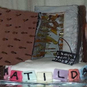 A Chokey inspired cake from Matilda the Musical. I have included the glass inside, the nails on the door and Bruce's I Have Been To Chokey sign. The door is tempered chocolate and the glass, melted down boiled sweets. Hope you like it!