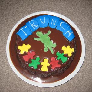 This is my cake for Miss Trunchball, made by a 13 year old. She would like this because it is a cake made especially for her and includes her worst enemies, children and the newt she nearly drank( Made of fondant icing). I think Miss Trunchball would like to get revenge on these 2 things.It is the recipe of Bruce Bogtrotters cake which as we know is Miss Trunchball's favourite type of cake!!