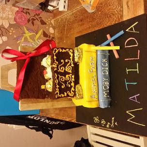 #MatildaBakeOff this is my matilda cake entry hoping to get tickets to see Matilda the musical so I can take my little sister for an extra special 21st birthday weekend. I couldn't post this on instagram incase she saw it and was disappointed I didn't win but please please choose me, Matilda is my sisters favourite movie and book of all time and she knows every word in the movie. I'd love to take her away for an extra special weekend, if I don't win she will be over the moon with me getting her standard tickets but I'd love to give her the best 21st ever!!  Also her birthday is on the 21st of this month so this competition fell so perfectly... even if my cake decoration skills (this is only my 3rd ever cake decoration mind) are lacking I tried to use my imagination as much as possible without over doing it. Fingers crossed over here!!!!